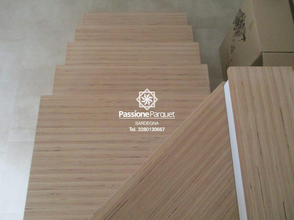 Passione Parquet.Montaggio scala in faggio e posa parquet con battiscopa bianco.( zona Cagliari ) tel 3280130667